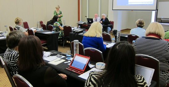 presenters Kathy Riessen, Alan Blackburn and Josie Howse addressing seated workshop participants